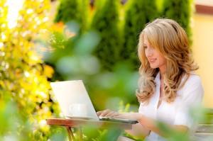Girl writing on her laptop